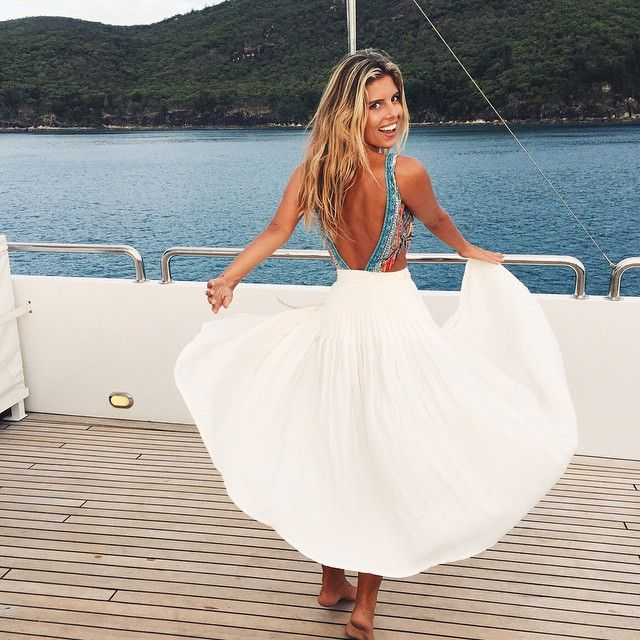 Natasha Oakley. White skirt. Camilla swimwear. Twirling on a boat. This is perfect