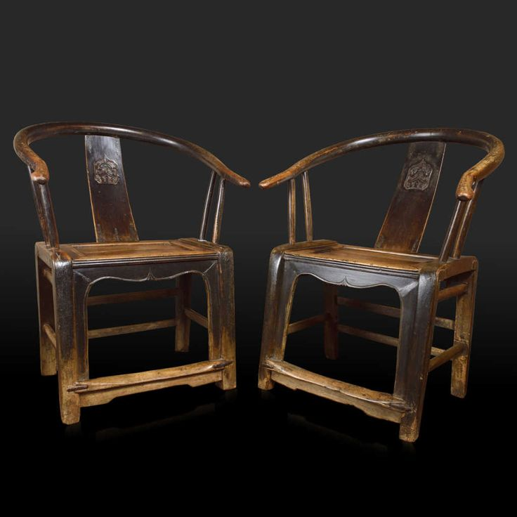 "Pair of Horseshoe-back armchairs, Shanxi (North-East China), XIX Century Elegance and solidity, in the most authentic tradition of Chinese craftsmanship, characterize this ceremonial chair, also known as ""Chair of the Great Guardian"" (taishi yi), a piece of furniture that can transform any room. A single piece of curved elm characterizes the typical back."