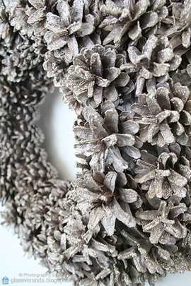 Hanging on our front door at Christmas: A door-wreath made out of pine cones, vaguely spray painted silver and sprinkled with micro glitter, -giving it a frosty-look! ;)) Styling and photography by Ann, Glassveranda. (glassveranda.blogspot.com)