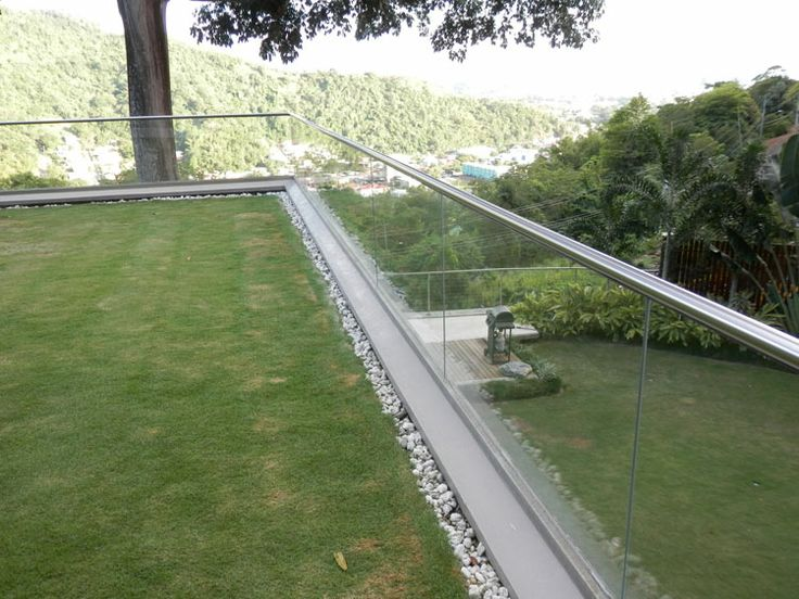 Frameless Glazing Channel, installed on a raised patio balcony in Trinidad, West Indies. Supplied by Elite Balustrade Systems in July 2011.