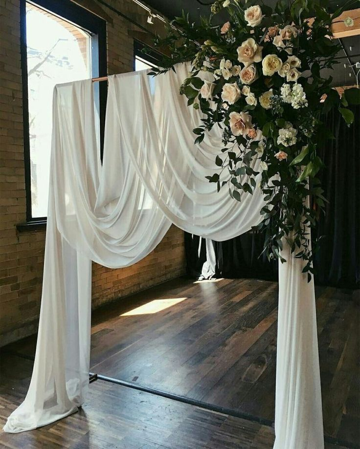 romantic white drapery and floral greenery wedding arch ideas