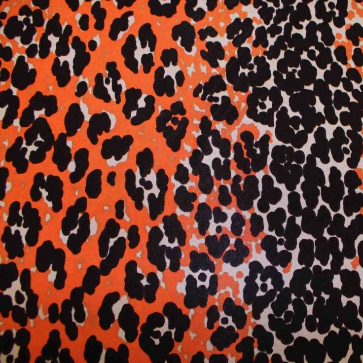 This print is sure to make a bold statement!  It's a printed light weight single-knit fabric, adorned with a leopard graphic print in orange, black, and white