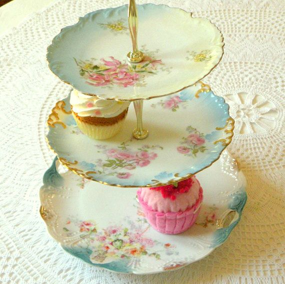 Three tiers of vintage china in ethereal pale sky blue for tea and cupcakes by High Tea For Alice