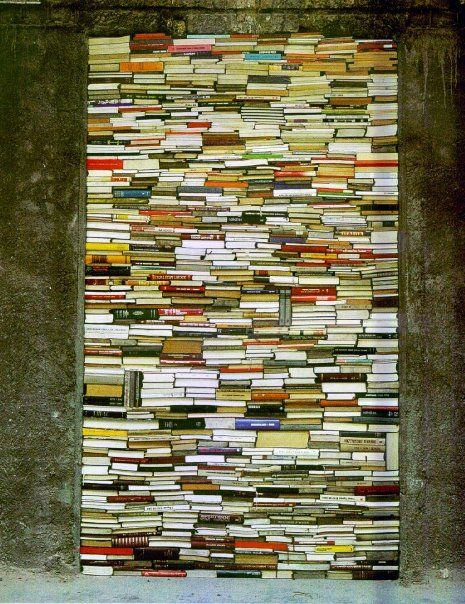 by Jannis Kounellis.....books arranged as a work of art as seen in contemporary quilts and paintings