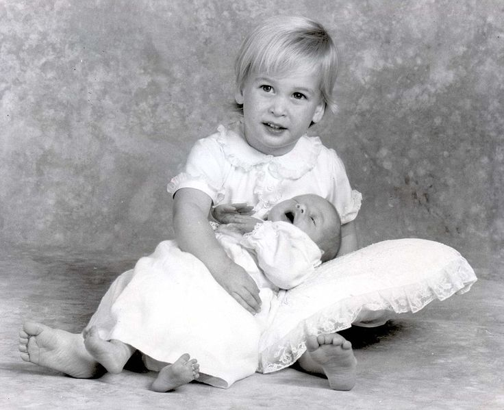 Prince William holds his baby brother, Prince Harry, photographed at Kensington Palace on October 5th, 1984