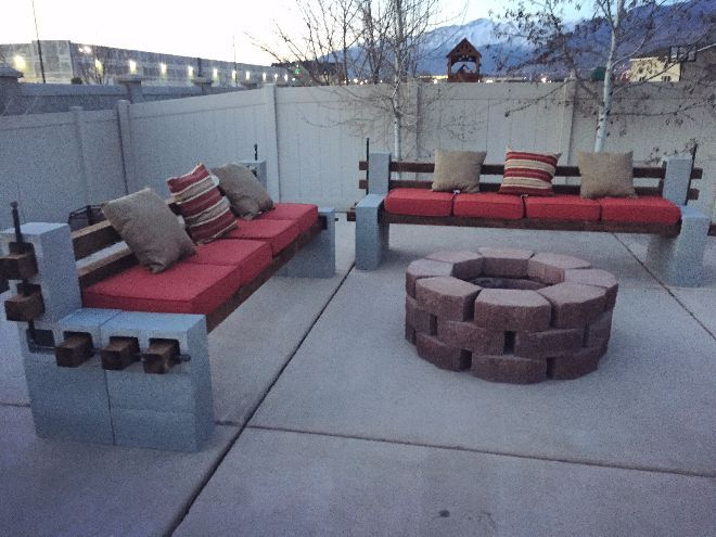 Man converts unused cement space in backyard to hold DIY benches and firepit