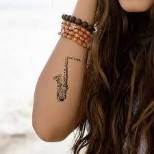 Image result for saxophone tattoos