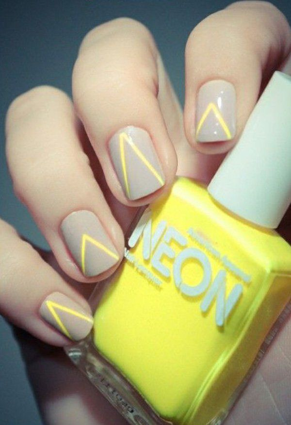 Gray and yellow nail art combination. Paint on thin yellow v-lines on top of your matte gray nails and make a statement in fashion.