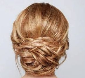 Cute, straight forward photo tutorial. Simplistic low updo.