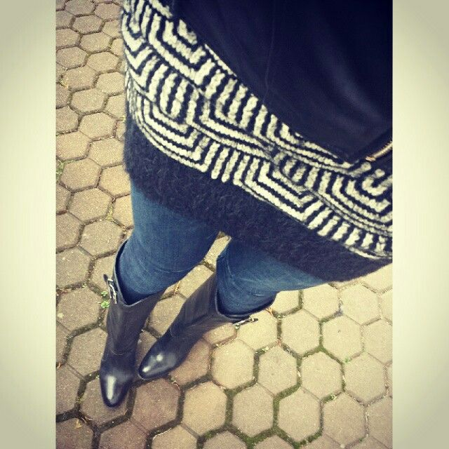 Black tall boots and dark blue jeans.