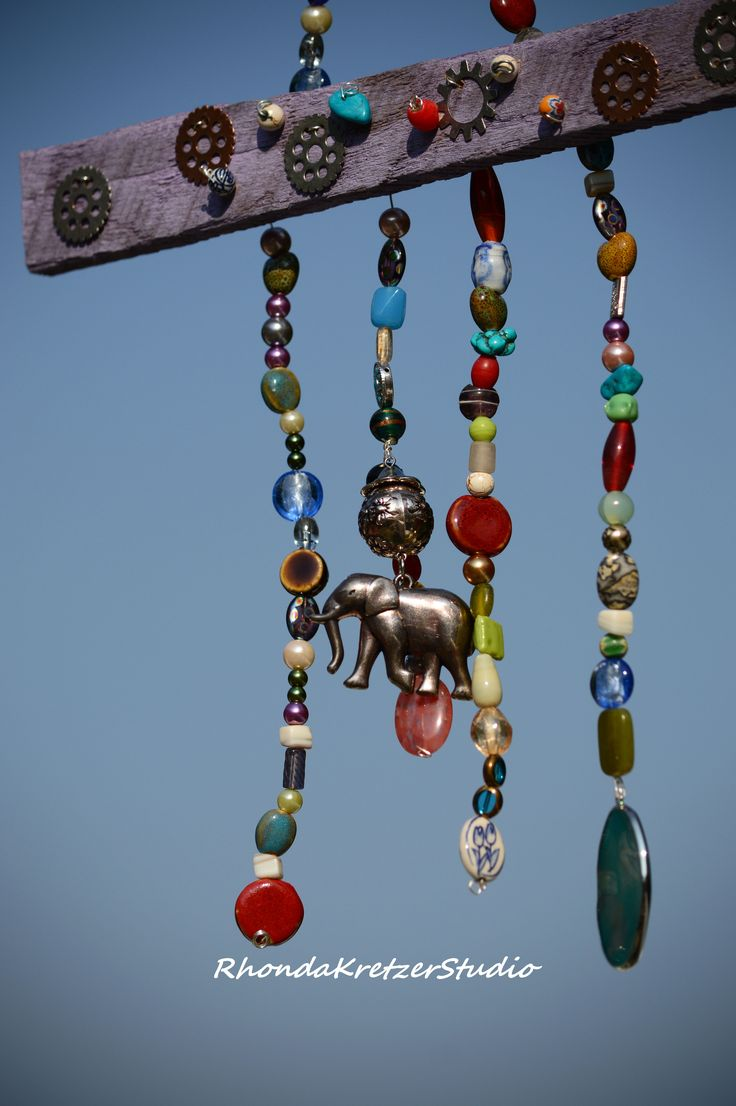 Boho hippie chimes made with wood ceramic and glass beads and an elephant amulet