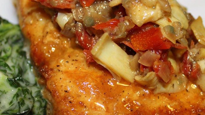 This recipe is for pan-fried mahi mahi topped with a white ...