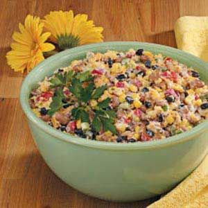 Corn Bread Confetti Salad Recipe  I've taken this to several gatherings this summer and it's always a hit. Recipe feeds a lot of people. :) If you make it ahead of time, wait until just before serving to add the cornbread.