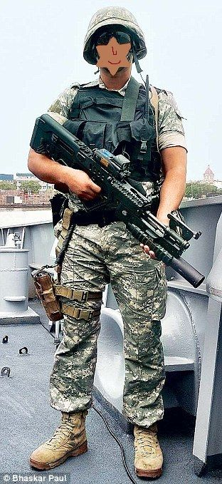 Indian Navy's Marine Commando(MARCOS) with a Tavor rifle . [312 x 769]