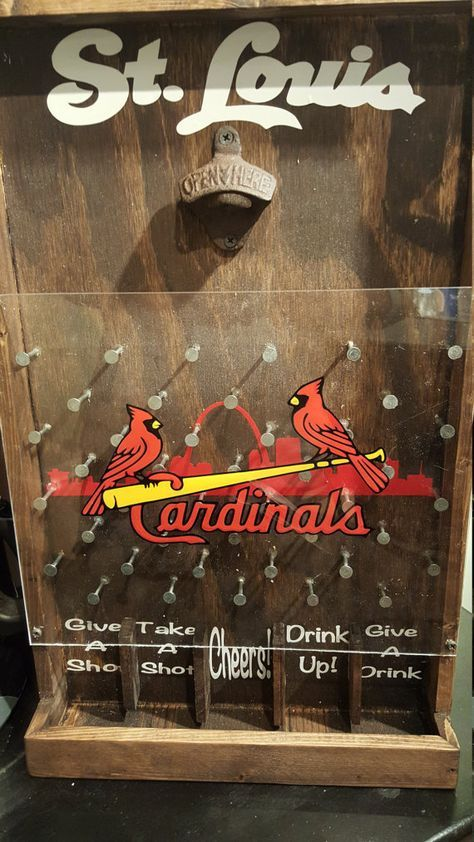 The perfect gift for any St. Louis Cardinals fan!  Add a little fun and whimsy with the drinking version of the game Plinko. This will be a great addition to your bar, game room, or man cave!  Item pictured is finished with walnut stain and rustic bottle opener but also available in an oak, mahogany and ebony finish. Chrome bottle opener also available. Choose your stain and opener preference during checkout. Made with durable plexiglass and measures approximately 21 X 13.  Two styles…