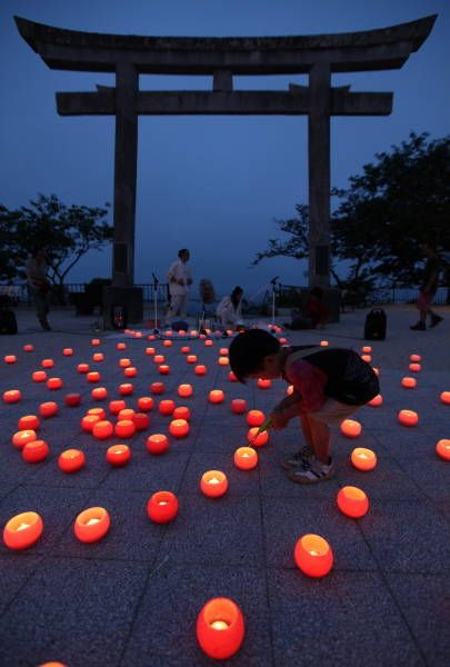 Lighting candles for lost souls in Ishinomaki, Miyagi, Japan