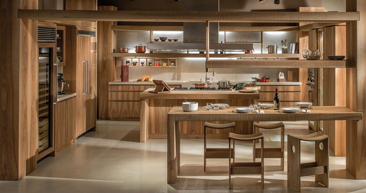 National walnut kitchen finished by hand plane, with hammered and brushed marble top of Botticino.  #Habito #GiuseppeRivadossi #design #Italy #kitchen #wood