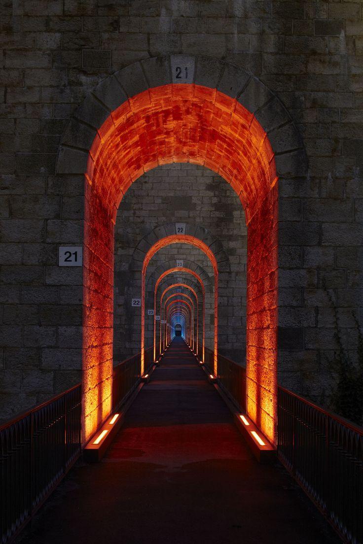 Chaumont Viaduct, France. Lighting design: Jean-François Touchard - Lighting products: iGuzzini illuminazione - Photographed by Didier Boy de la Tour #iGuzzini #Light #Lighting #Red #corridor #color
