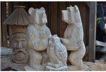 Dřevěné sochy (medvědi, sova, klát) vyřezávané motorovou pilou. Realizace Sruby Pacák s.r.o.