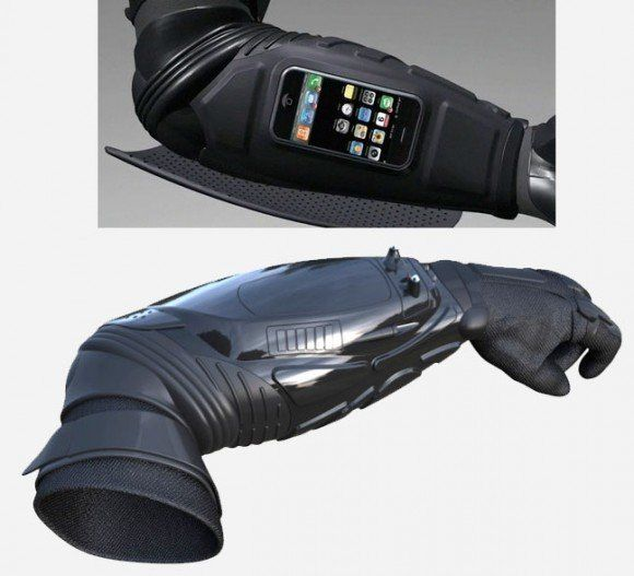 The Batman Inspired Kevlar Gauntlet Is Both An iPhone Dock And Wearable Body Armor   Featuring a working stun device, camera, flash light and iPhone / iPod dock, all in one piece of Kevlar arm armor