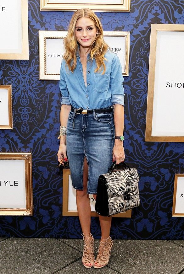 Olivia Palermo in a denim pencil skirt and oxford, and lace-up heels.