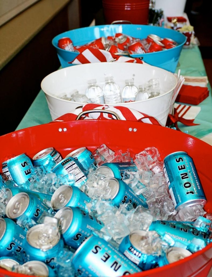 red and aqua wedding -- aqua and red tubs filled with Jones soda and Big Red at the reception