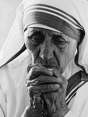 Mother Theresa. If I can be half the human being that she was. Peace and Love.