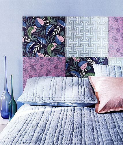 Scrapbook paper for a headboard? Yeah ... Use foamcore for the backing with scrapbooking paper for design then affix to wall with Velcro. Easy DIY headboard that's cheap and won't damage your walls! Plus, you can change out the paper for new colors and design. You can also do this with fabric!