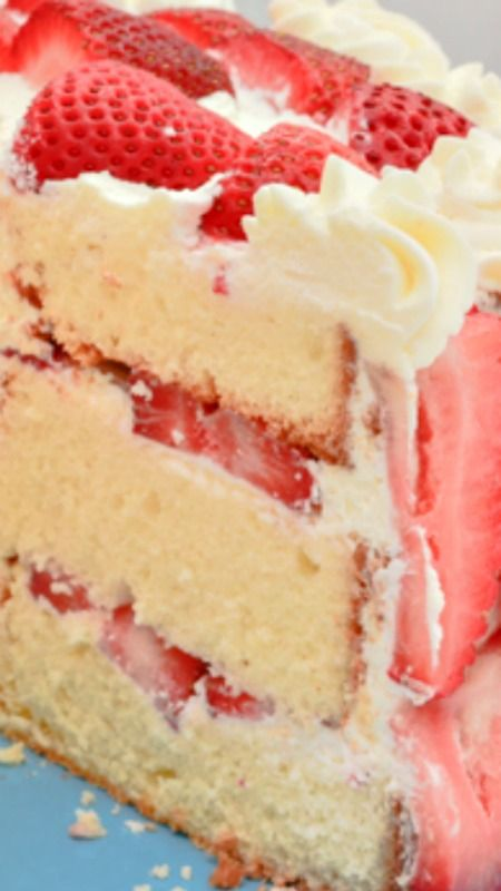 Strawberries 'n Cream Cake ~ Heavenly. Because not only does this cake look amazing, it tastes just as delicious. With fresh strawberries, homemade whipped cream, and a pound-cake-type texture