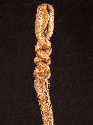 a folk art cane richly carved with four rising Cobra design Continental  date circa: 1890