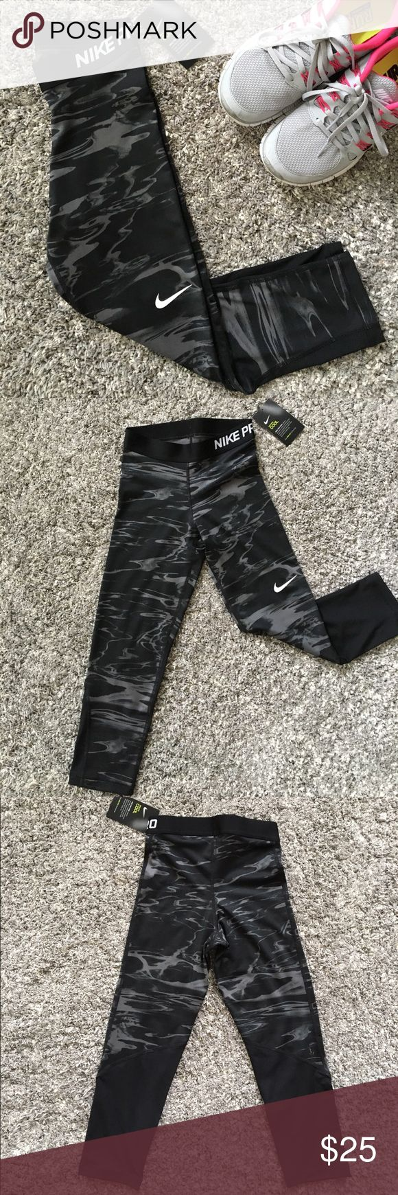 Nike Pro Training Capris Black and Gray Brand new Nike Pro Training Capris Black and Gray. Mesh panels below the knee in the back for breathability. Size XS. Ships fast! Nike Pants Leggings
