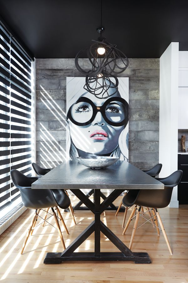 Peau de béton Cement-Like Wall Tiles At Ciot | Create a dramatic feature wall using lightweight concrete panels, available in five colours. In this dining room the cool, textural greys complement the modern industrial style.