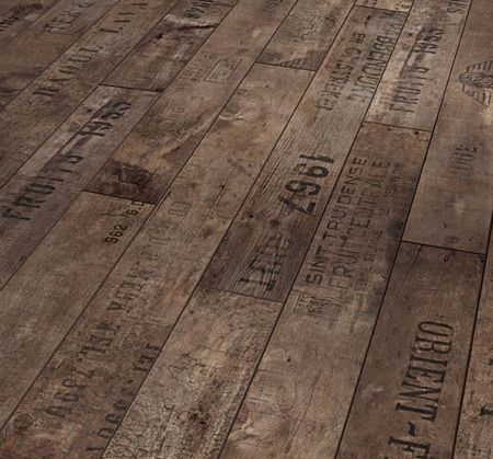 Rustic Wine and Fruit Flooring from German flooring company Parador. The pattern was inspired by flooring found in old European cellars, which were often made of wood from discarded wine crates with fired-on inscriptions and dates.
