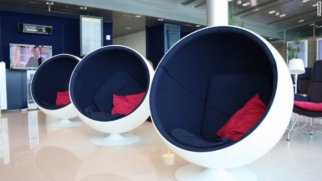 Finnish and Nordic furniture designs complement the clean aesthetic at the Finnair Lounge in Helsinki Airport.