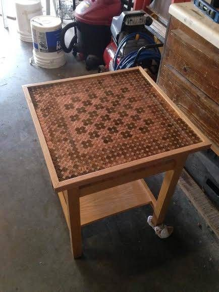 Once the pennies were arranged to create a chess board, epoxy was used to seal them to the surface. There you have it - a penny chess table.