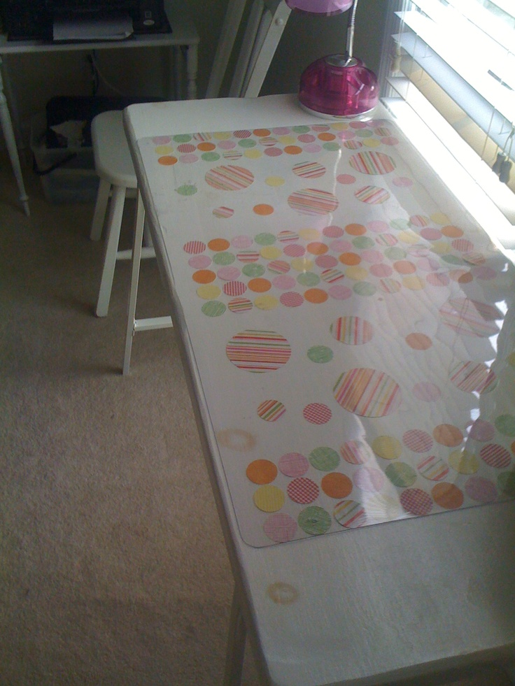 Ikea's Vika Lerberg+ Re-purposed coffee table top and desk protector + scrapbook paper = new cutting table
