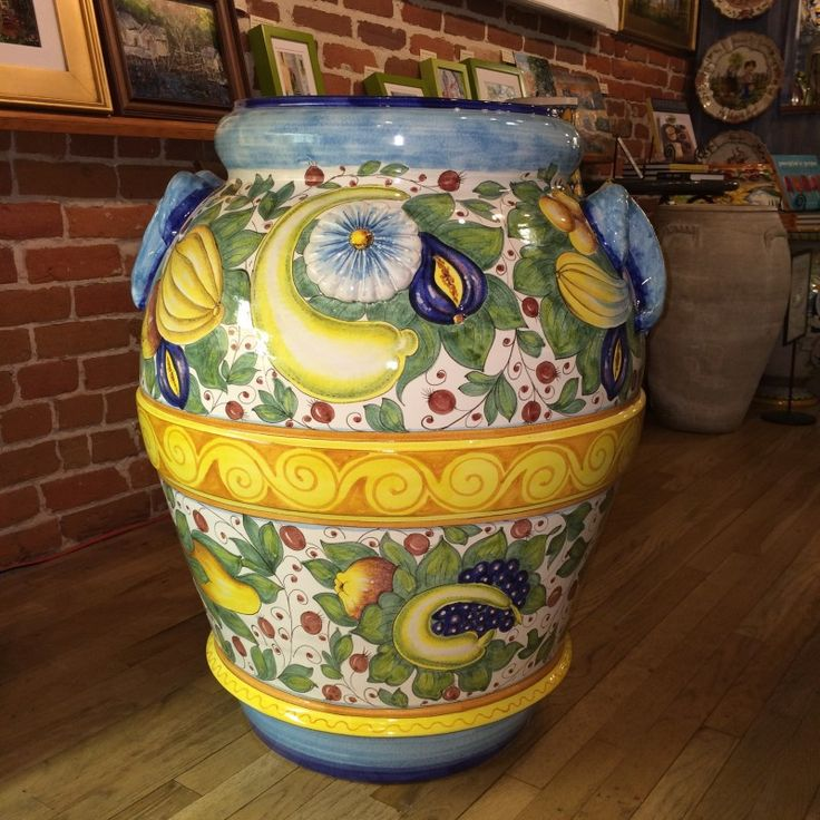 Very Large Italian Ceramic Scenic Urn - Take a trip to Tuscany and sample some local fruit! This very large Italian ceramic urn is a virtual plethora of Tuscan abundance. Take a walk around to the back and you find yourself in the countryside meeting with neighboring herdsmen next to a flowing stream. Entirely handmade and hand painted in Tuscany. From the Italian Pottery Outlet in Santa Barbara, CA.