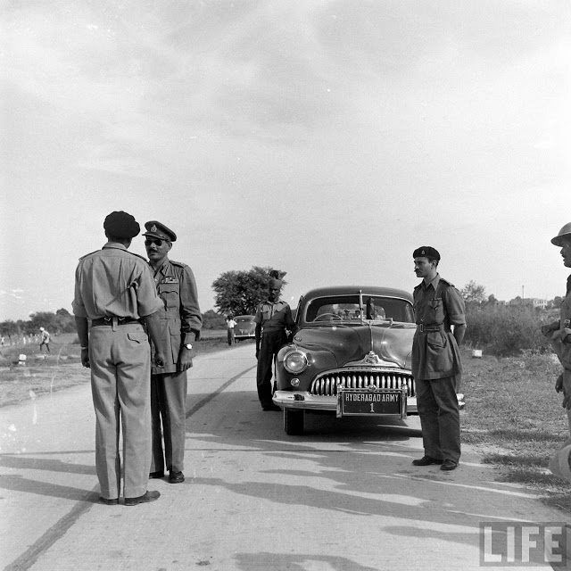 Major General Joyanto Nath Chaudhuri talking with Major General Syed Ahmed El Edroos, Commander-in-Chief of the Hyderabad State Forces