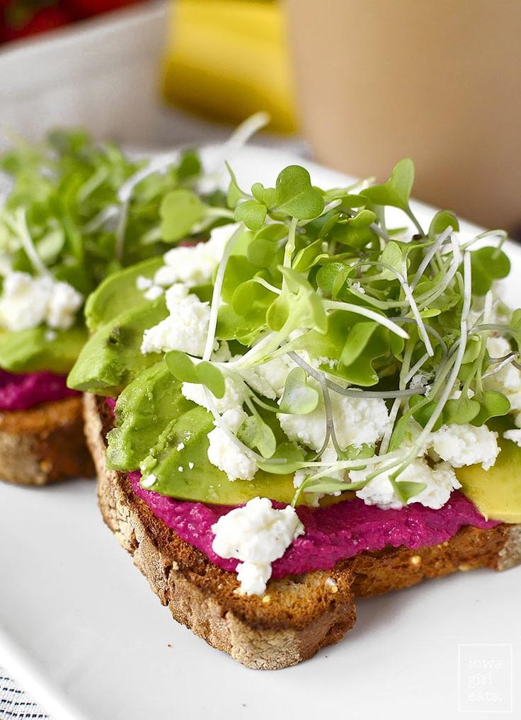 Avocado toast with beet hummus, goat cheese and microgreens. Perfection!