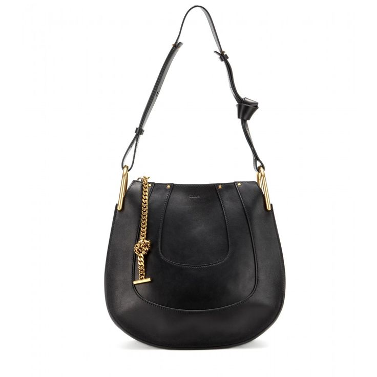 Chloé - Hayley Small leather shoulder bag - Panels of grainy black leather give the 'Hayley' shoulder bag from Chloé a soft, bohemian look. The roomy silhouette it elevated with gold-tone hardware for a seasonless look you'll return to again and again. Note the knotted leather shoulder strap - a small detail that finishes the simple and chic look. seen @ www.mytheresa.com