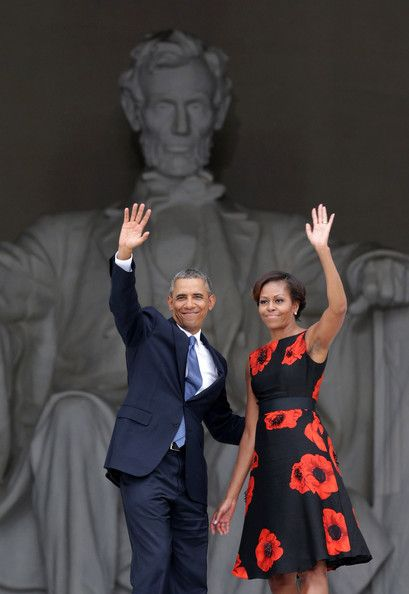 "U.S. President Barack Obama (L) and first lady Michelle Obama wave as they leave at the end of the Let Freedom Ring ceremony at the Lincoln Memorial August 28, 2013 in Washington, DC. The event was to commemorate the 50th anniversary of Dr. Martin Luther King Jr.'s ""I Have a Dream"" speech and the March on Washington for Jobs and Freedom. (August 27, 2013 - Source: Alex Wong/Getty Images North America)"