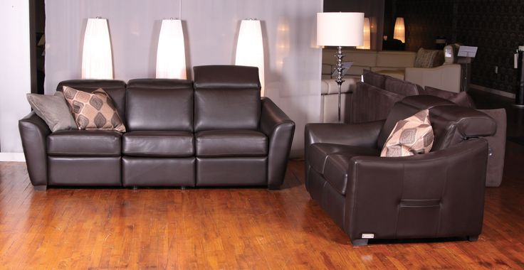 Julianne leather sofa by Jaymar made in Canada. Retractable head-rest and Motorized reclining mechanism. Sofa made in Canada