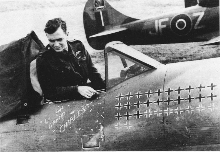 """Pierre Clostermann, DSO, DFC and bar in the cockpit of """"Le grand Charles"""", his Hawker Tempest Mk. V. The french ace of WWII with 33 victories. He started the war on Spitfires with the No 341 Squadron RAF (also known as Groupe de Chasse n° 3/2 """"Alsace"""" to the free french force) before joining No 274 Squadron RAF in december 1944."""