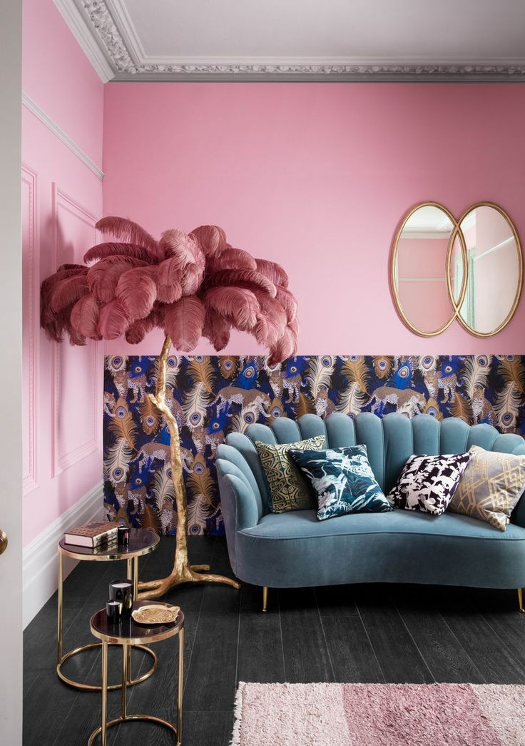 Pink wall, feather palm leaf ornament and teal velvet sofa – House of Fraser