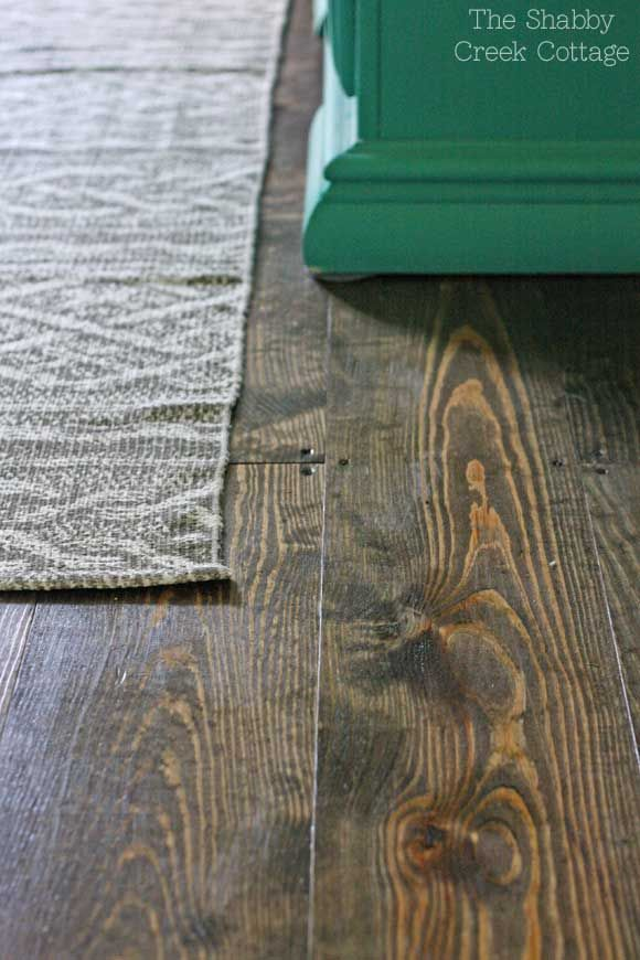 DIY wood floors from 1x plank pine wood. Cheap real wood floors for only 75 cents a square foot.