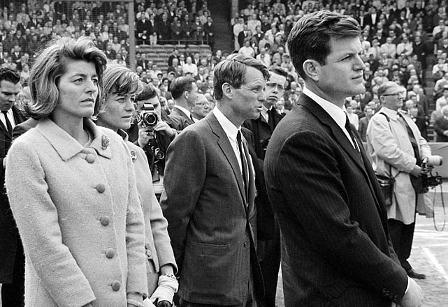 Pat Lawford and Jean Smith, sisters of late president John F. Kennedy, join Robert and Ted Kennedy during a pregame ceremony for the deceased president.  Photographed by: Bettmann/CORBIS