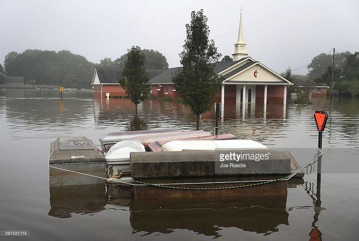 Caskets are seen floating in flood waters near a cemetery