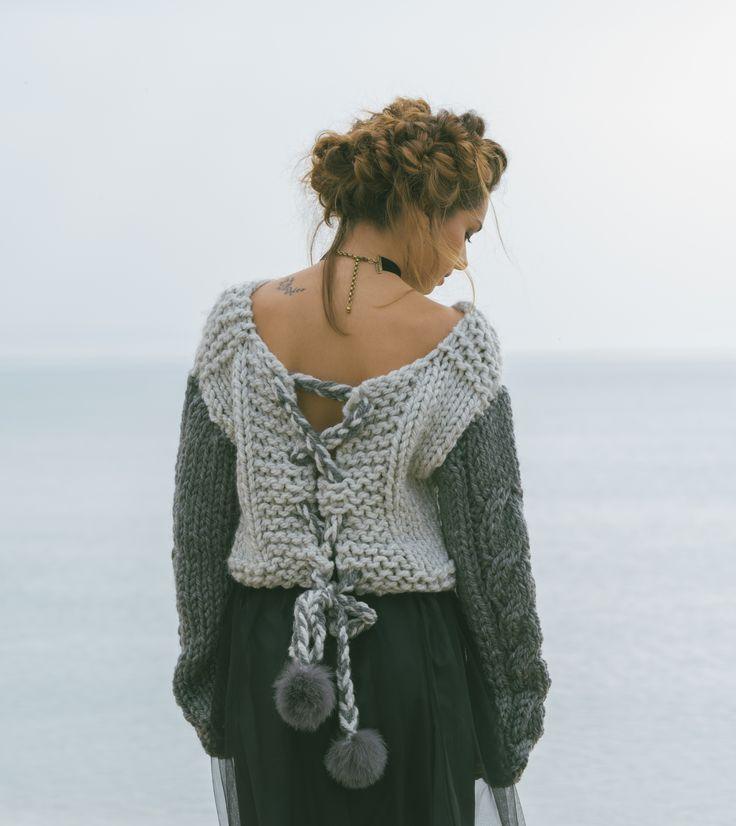 So cozy cute, open-back amazing grey sweater with the most stylish dark grey braid knit sleeves.