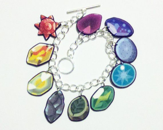 Pokemon Evolutionary Stone Charm Bracelet -- WANT SO BAD. It would be super cute to take them off the chain and put one on a necklace