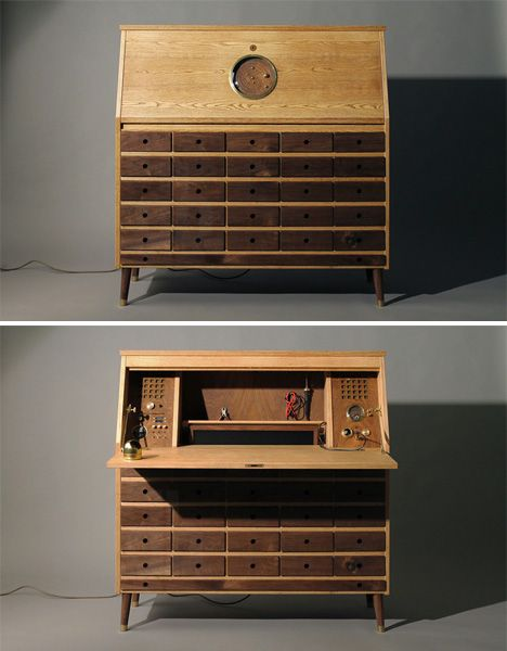 Constructed of ash, walnut and brass, the table was custom-made for the designer's own use crafting small electronic projects. The lid of the traditional writing desk conceals a pop-up monitor, computer, speaker system, built-in soldering station and other tools.